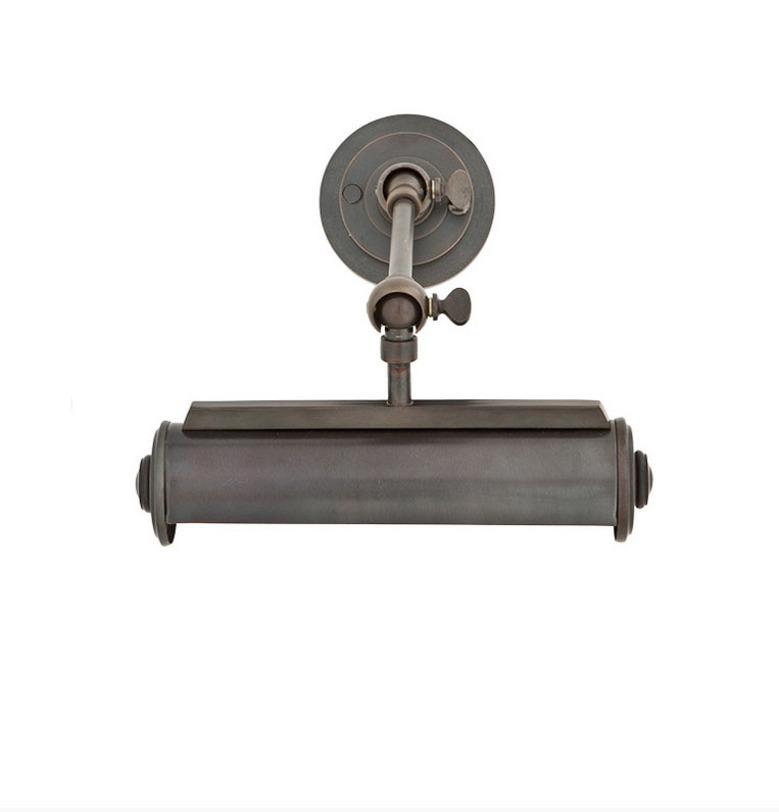 Подсветка для картин Lamp Wall Easy LivingПодсветки для картин<br>Настенный светильник в индустриальном стиле изготовлен из металла в цвете состаренной бронзы. Используется для подсветки картин или как настенный светильник. Шарнирные узлы позволяют регулировать направление света и угол наклона.<br><br>Количество лампочек: 1<br>Мощность: 1x 40 Вт<br>Тип лампы: E14<br><br>Material: Металл<br>Length см: None<br>Width см: 21<br>Depth см: 7<br>Height см: 29<br>Diameter см: None