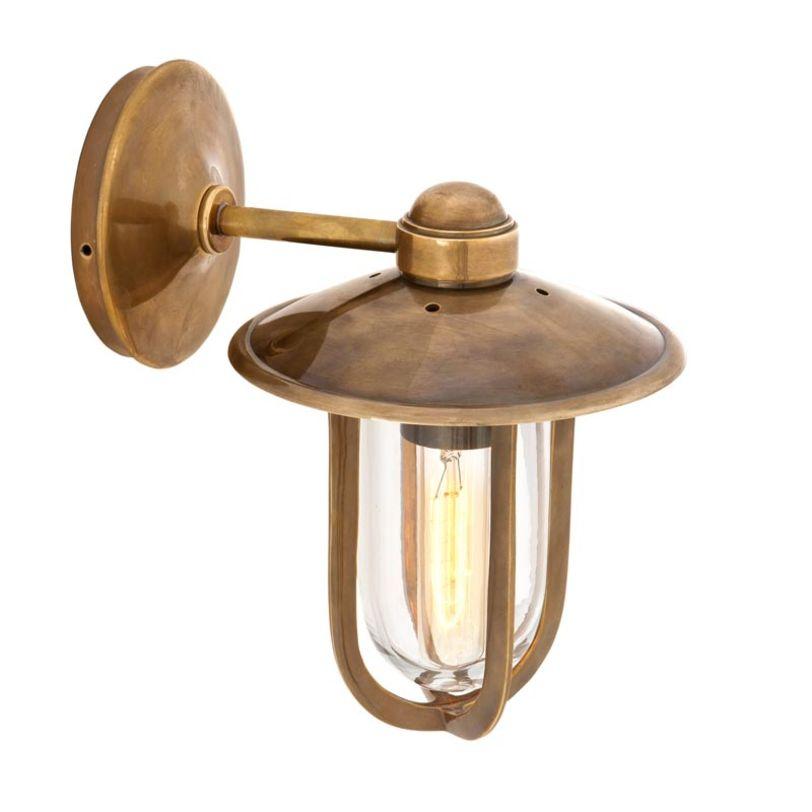 Бра Seg HarbourБра<br>Бра в современном стиле, с арматурой из металла, цвет - состаренная латунь. Плафон (рассеиватель) из прозрачного стекла. Светильник стилизован под уличный фонарь.<br>Количество лампочек: 1<br>Мощность: 1x 40 Вт<br>Тип лампы: E27<br><br>Material: Металл<br>Length см: None<br>Width см: 11,6<br>Depth см: 16<br>Height см: 38<br>Diameter см: None