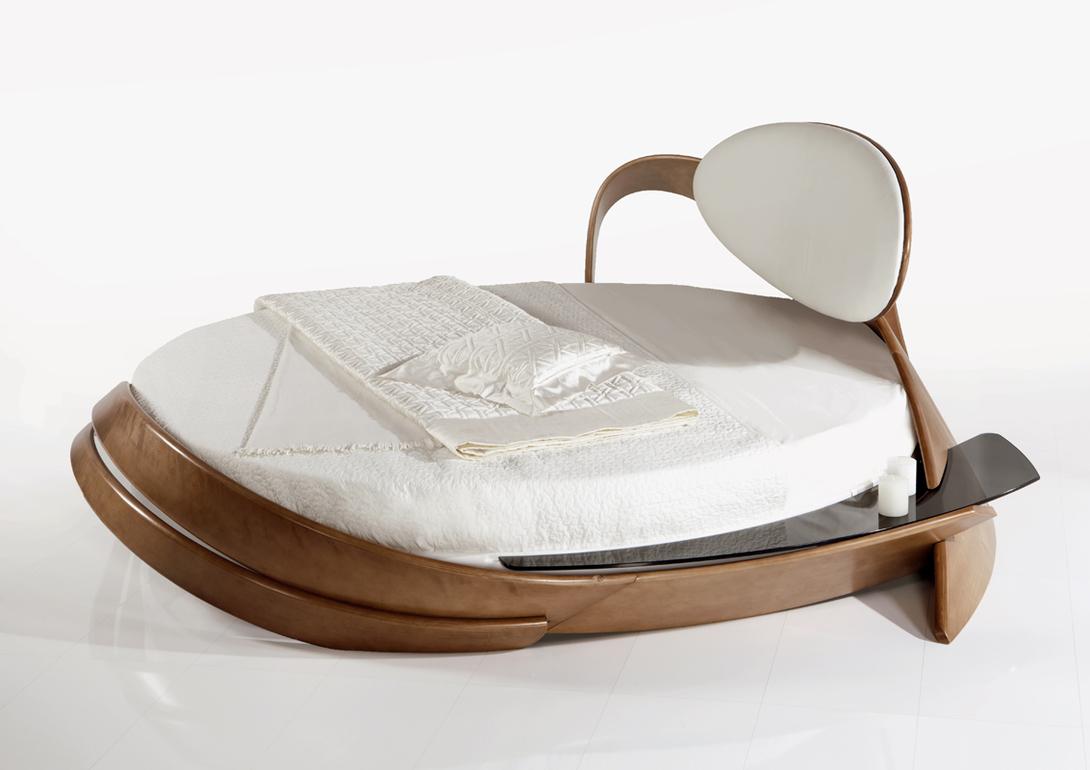 Кровать BrazoКровати с мягким изголовьем<br>&amp;lt;div&amp;gt;Круглая дизайнерская кровать из асимметричной коллекции. В основе конструкции кровати находится металлическое основание, что делает её очень прочной при легкости внешнего образа. Все декоративные элементы выполнены из натурального дерева. Гармонично смотрится в комплекте с туалетным столом той же серии.&amp;amp;nbsp;&amp;lt;/div&amp;gt;&amp;lt;div&amp;gt;&amp;lt;br&amp;gt;&amp;lt;/div&amp;gt;&amp;lt;div&amp;gt;Материал: Натуральное дерево береза, 10 вариантов тонировок.&amp;amp;nbsp;&amp;lt;/div&amp;gt;&amp;lt;div&amp;gt;Обивка: износостойкая ткань коллекции sensation (6 оттенков).&amp;lt;/div&amp;gt;&amp;lt;div&amp;gt;&amp;lt;span style=&amp;quot;font-size: 14px;&amp;quot;&amp;gt;Кровать поставляется с матрасом: d 220 см.&amp;lt;/span&amp;gt;&amp;lt;/div&amp;gt;&amp;lt;div&amp;gt;&amp;lt;br&amp;gt;&amp;lt;/div&amp;gt;<br><br>Material: Береза<br>Length см: None<br>Width см: None<br>Depth см: None<br>Height см: 100<br>Diameter см: 255