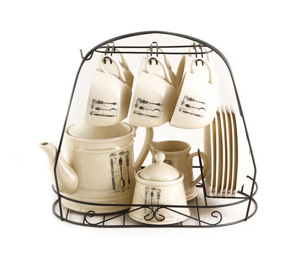 Чайный наборЧайные сервизы<br>Набор на 6 персон из 16 предметов на подставке.<br>Размеры: подставка - 33х20х30; чашка - 11,5х6,5х6,5; блюдце - 16х16х2,5; молочник - 9х9х11,5; сахарница - 10х-10х10; чайник - 22х13,5х17<br><br>Material: Керамика<br>Length см: None<br>Width см: None<br>Depth см: None<br>Height см: None<br>Diameter см: None