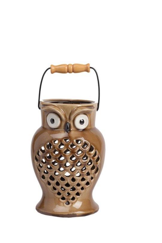 Подсвечник EpierПодсвечники<br>Очаровательный и милый подсвечник Epier поможет создать атмосферу праздника в вашем доме или романтический настрой, в зависимости от ваших желаний. Аксессуар изготовлен из грубой керамики в виде симпатичной совы. Цветовое решение позволяет украсить этим предметом декора как современный, так и классический интерьер. Удобная ручка поможет спокойно и без проблем переносить подсвечник в любое необходимое вам место.<br><br>Material: Керамика<br>Length см: 15,5<br>Width см: 15,5<br>Depth см: None<br>Height см: 23,5<br>Diameter см: None