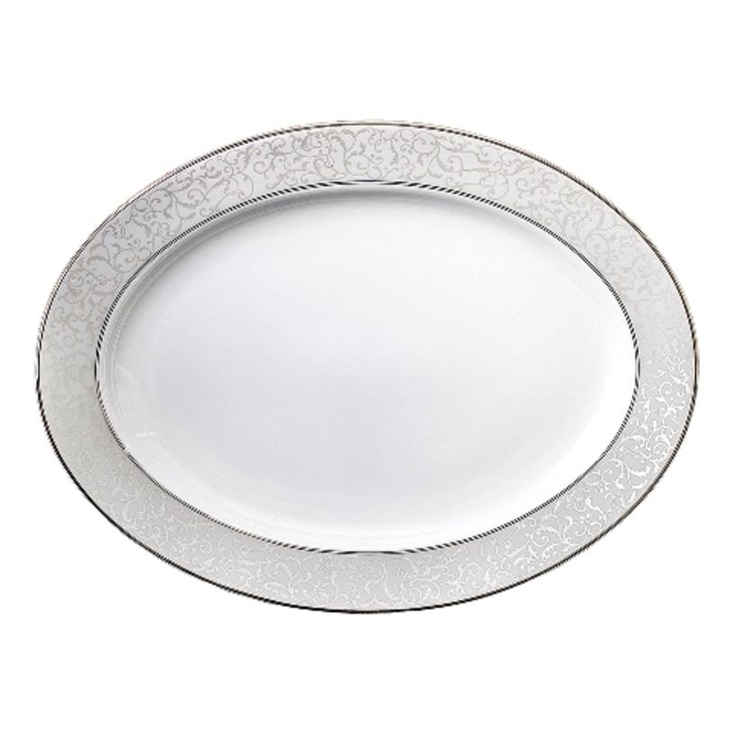 Блюдо овальноеДекоративные блюда<br>MIKASA по праву считается одним из мировых лидеров по производству столовой посуды из фарфора и керамики. На протяжении более полувека категории качества и дизайна являются неотъемлемой частью бренда MIKASA. Сегодня MIKASA сотрудничает со многими известными дизайнерами, работающими для лучших фабрик мира, и использует самые передовые технологии в производстве посуды. Все продукты бренда MIKASA безупречны с точки зрения дизайна и исполнения.<br><br>Material: Фарфор<br>Length см: 31<br>Width см: None<br>Depth см: None<br>Height см: None<br>Diameter см: None