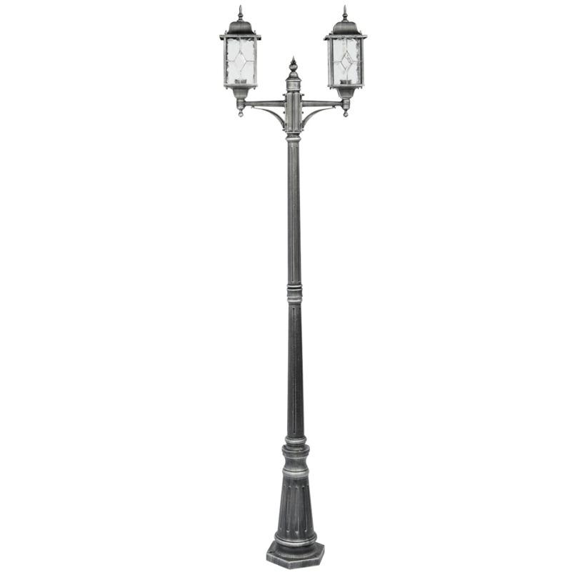 Светильник БургосУличные наземные светильники<br>«Бургос» – это образец винтажности, которая в последнее время считается атрибутом спокойной и успешной жизни. По своему внешнему виду он похож на старый уличный фонарь, поэтому будет отлично дополнять оформление садового участка в классическом дизайне.<br><br>Мощность: 2*100W<br>Цоколь: E27<br>Основание из литого алюминия черного цвета, декорированние серебряной патиной, плафоны – витражное стекло.<br>Рекомендуемая площадь освещения: 14 кв. м.<br><br>Material: Алюминий<br>Высота см: 225.0