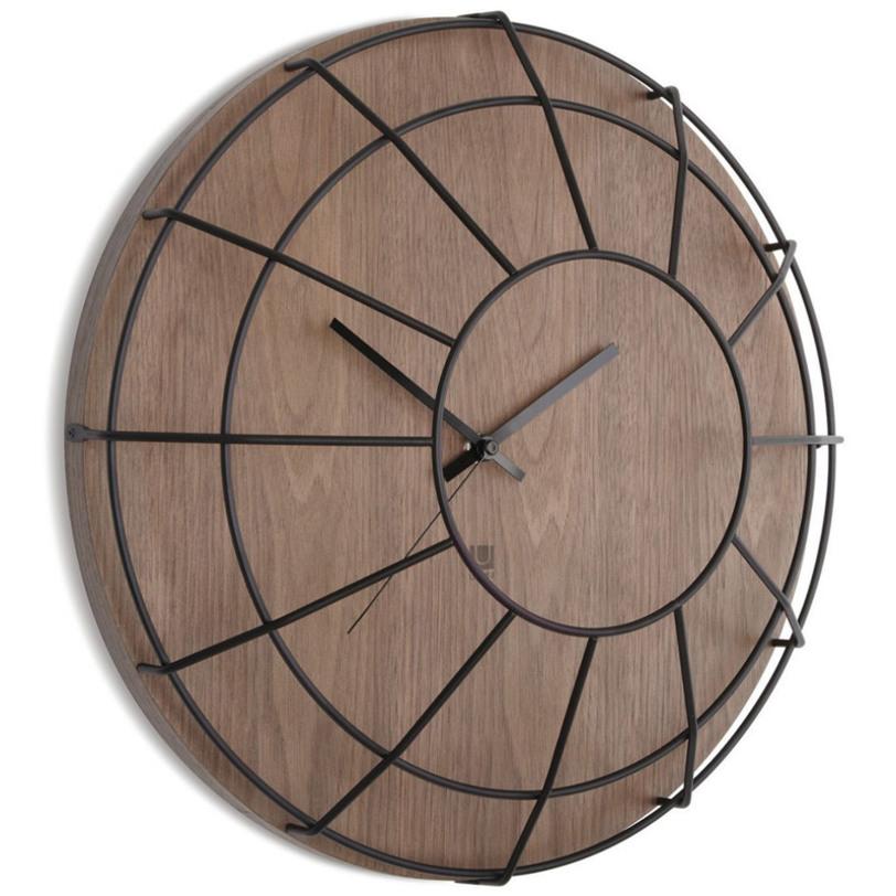 Настенные часы CageНастенные часы<br>Это уже что-то совсем необычное и крайне интересное! Часы с ретро акцентом, выполненные из сочетания дерева и металла, приковывают взгляд, и вы задаетесь вопросом &amp;quot;А как же это сделано?&amp;quot;. Их хочется рассматривать бесконечно. Так что советуем повесить их на самом видном месте, чтобы удивлять гостей, наслаждаться самому и, конечно же, пристально следить за временем.<br>У часов есть не только минутная, но и секундная стрелка. Вешаются на стену с помощью специального зазубренного крючка на задней стороне.<br><br>Material: Дерево<br>Length см: None<br>Width см: None<br>Depth см: 11,3<br>Height см: None<br>Diameter см: 40,6