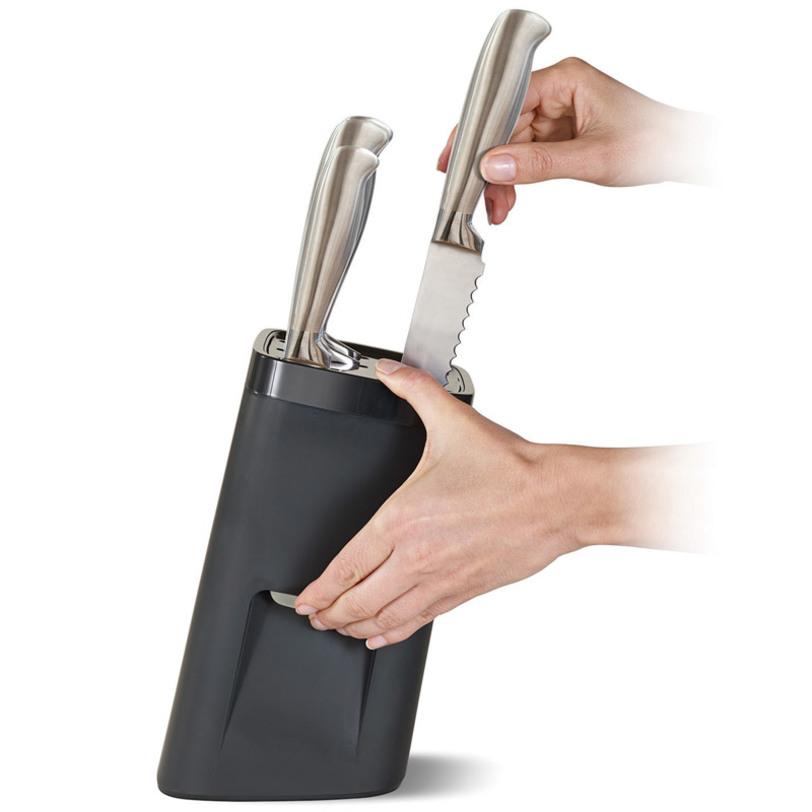 Подставка для ножей lockblockКухонные наборы посуды<br>Когда речь идет об острых кухонных ножах, главное - это безопасность. Особенно если в доме есть маленькие дети! В ящике стола ножи легко доступны, могут поранить вас, плюс могут затупить при трении друг о друга. Решает эти проблемы специальная подставка с системой автоблокировки.<br>Инновационная технология зажимов не позволит достать нож, если вы не нажмете на секретную кнопку. Система адаптирована под любую руку. Блок имеет нескользящее основание.<br>Подходит для ножей разных форматов (в комплект не входят).<br><br>Material: Пластик<br>Length см: 14<br>Width см: 14<br>Depth см: None<br>Height см: 24<br>Diameter см: None