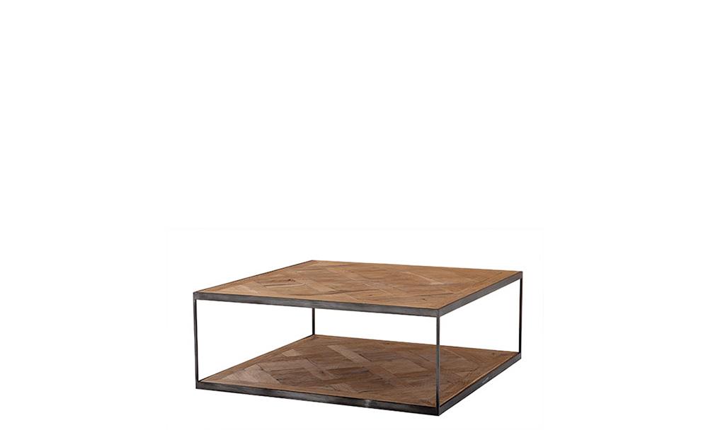 Стол журнальный ChateaudunЖурнальные столики<br>&amp;quot;Chateaudun&amp;quot; ? журнальный стол, главным элементом декора которого выступают симметричные подстолье и столешница. Строгие элементы, соединенные грубыми металлическими конструкциями, отделаны деревом. Рисунок напоминает паркетную кладку ? именно это придает брутальному облику промышленного стола элегантность.<br><br>Material: Дерево<br>Length см: 65<br>Width см: 65<br>Height см: 38