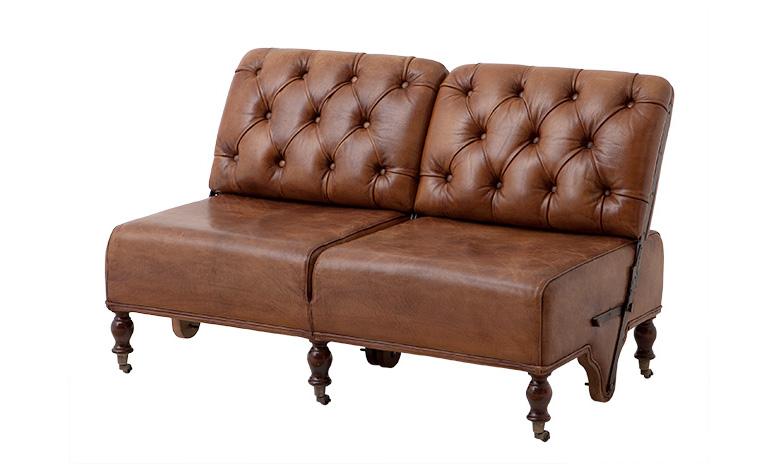 Диван Tete-a-teteКожаные диваны<br>Именно на тщательной проработке всех мелочей сделан акцент при создании коллекций Eichholtz, поэтому каждый элемент имеет свои уникальные особенности, будь то диваны, столы, стулья, светильники или люстры Eichholtz.<br><br>Material: Кожа<br>Length см: 131<br>Width см: 73<br>Height см: 91