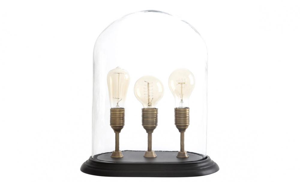 Настольная лампа SargentДекоративные лампы<br>&amp;quot;Sargent&amp;quot; своим видом больше напоминает музейный экспонат, а не настольную лампу. Винтажный облик, бережно сохраненный внутри стеклянного &amp;quot;купола&amp;quot;, позволяет ей смотреться оригинально. Источники света, такие разные по форме, но схожие по оформлению, являются изюминкой оформления лампы. Она отлично впишется в интерьер лофт, для которого великолепно подходят старинные силуэты с аскетичной отделкой.&amp;lt;div&amp;gt;&amp;lt;br&amp;gt;&amp;lt;/div&amp;gt;&amp;lt;div&amp;gt;Количество ламп (3), цоколь (27Е), мощность (40Вт).&amp;lt;/div&amp;gt;<br><br>Material: Латунь<br>Ширина см: 34<br>Высота см: 44<br>Глубина см: 22