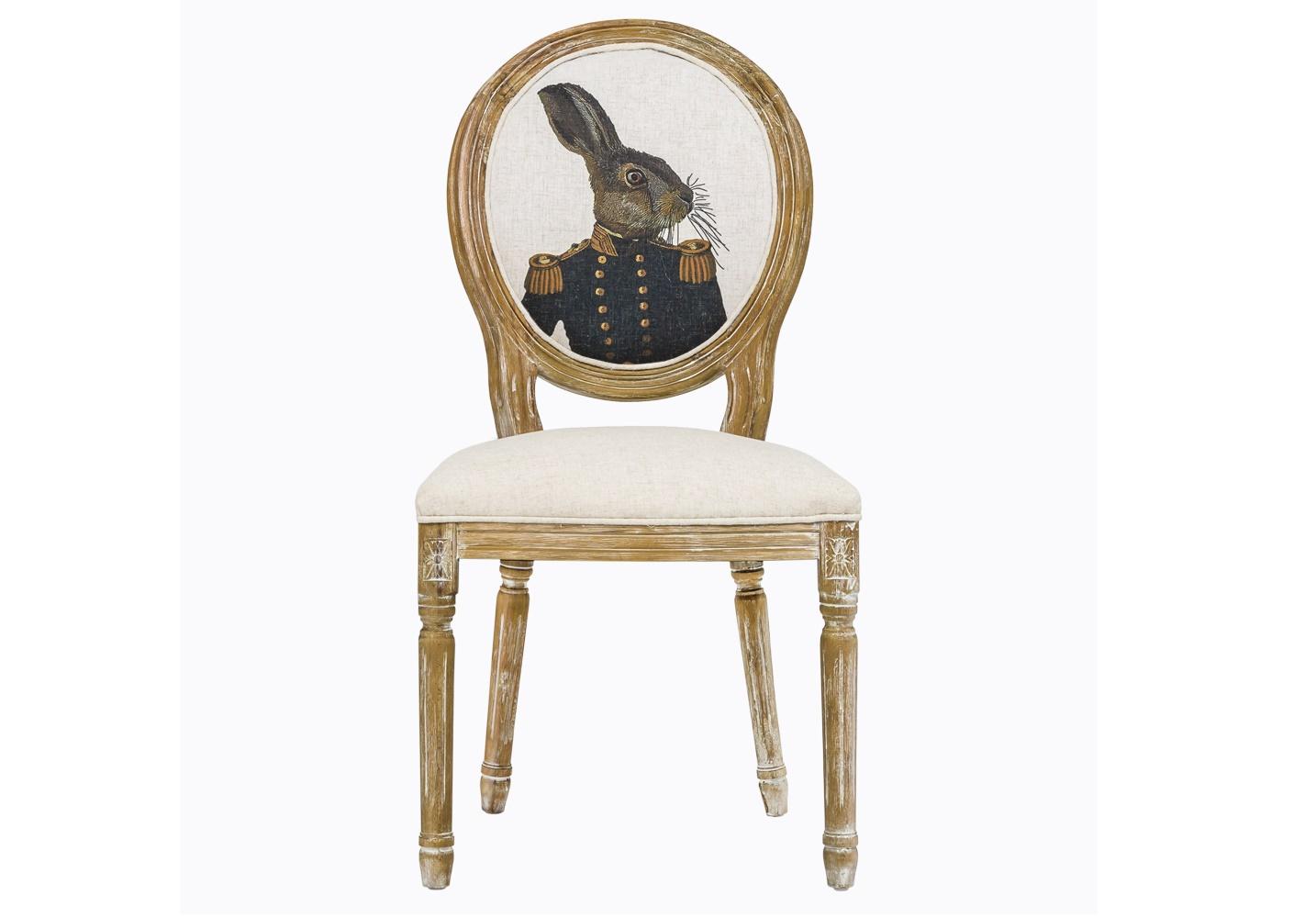 Стул «Мистер Заяц Лайт»Обеденные стулья<br>Поклонников Льюиса Кэролла и &amp;quot;Алисы в стране чудес&amp;quot; эта мебель приведет в восторг. Овальную спинку стула украшает оригинальный рисунок в стиле парадных портретов XVIII века. Длинноухий зайка, явно благородного сословия, облачен в офицерский китель с золотыми пуговицами и эполетами. Чем не дворянин? Сам стул – в духе эпохи Луи-Филиппа во Франции: изумительная ручная работа, тонкая резьба по древесине бука, а обивка – из светлой ткани со специальной пропиткой, защищающей от пятен.&amp;lt;br&amp;gt;<br><br>Material: Текстиль<br>Ширина см: 50.0<br>Высота см: 98.0<br>Глубина см: 57.0