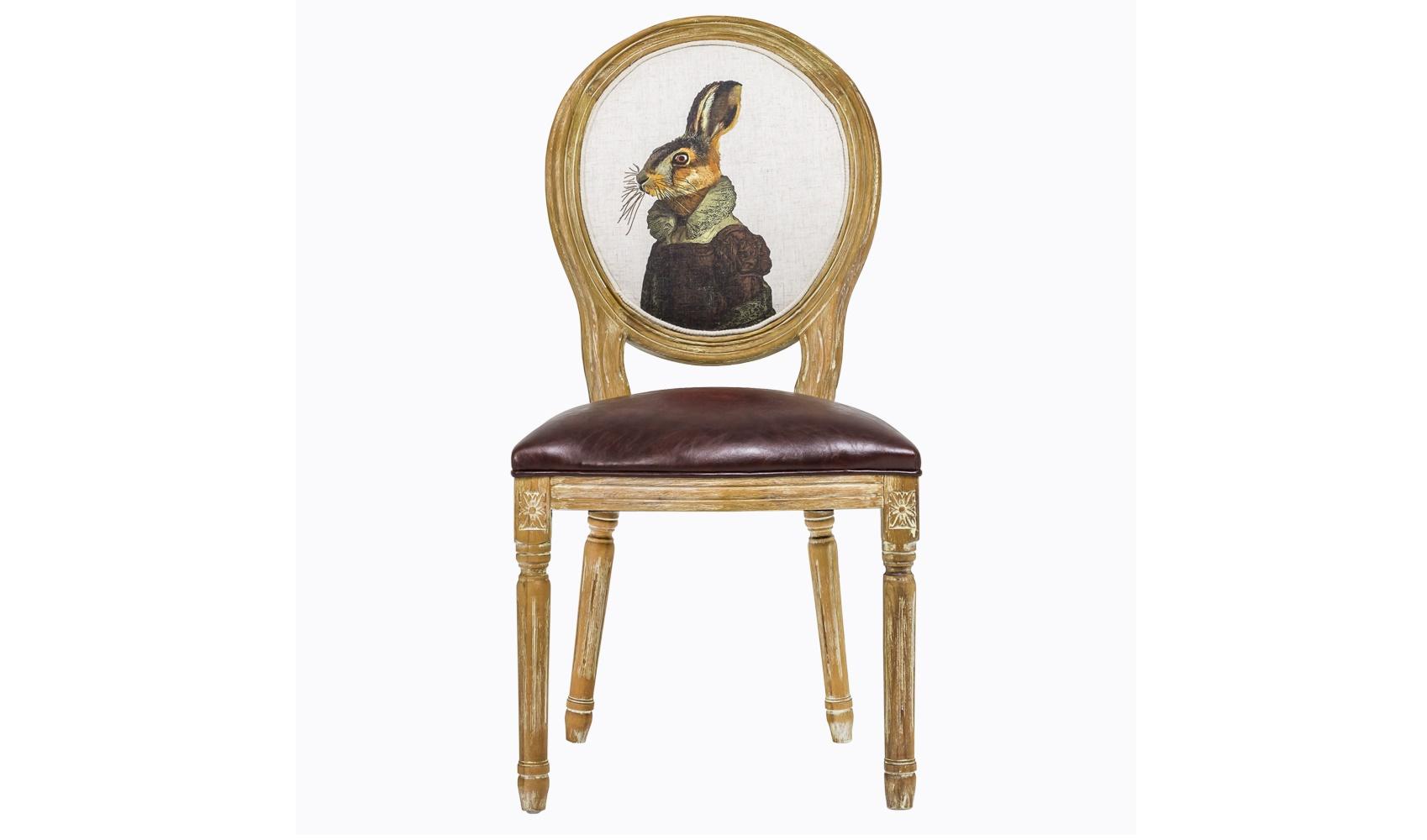 Стул «Мисс Зайка»Обеденные стулья<br>&amp;lt;div&amp;gt;Это не стул. Это ядреная смесь романтичного винтажа, французской роскоши и поп-арта. В центре внимания – овальная спинка-медальон с изображением экстравагантной зайки в старинном бальном платье. Ножки и основание стула выточены из цельной древесины и вручную покрыты филигранной резьбой, а для пущего эффекта – искусственно состарены и выбелены. Тканевая обивка пропитана специальным составом, который не только повышает прочность и долговечность материи, но и делает ее стойкой к загрязнениям. Обивка сиденья – эко-кожа. Вес – 7 кг.&amp;lt;/div&amp;gt;<br><br>Material: Кожа<br>Ширина см: 57<br>Высота см: 98