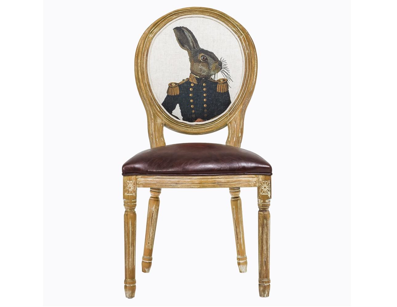 Стул «Мистер Заяц»Обеденные стулья<br>&amp;lt;div&amp;gt;Поклонников Льюиса Кэролла и &amp;quot;Алисы в стране чудес&amp;quot; эта мебель приведет в восторг. Овальную спинку стула украшает оригинальный рисунок в стиле парадных портретов XVIII века. Длинноухий зайка, явно благородного сословия, облачен в офицерский китель с золотыми пуговицами и эполетами. Чем не дворянин? Сам стул – в духе эпохи Луи-Филиппа во Франции: изумительная ручная работа, тонкая резьба по древесине бука, а обивка – из прочной и практичной эко-кожи. Вес стула составляет 7 кг.&amp;lt;/div&amp;gt;<br><br>Material: Кожа<br>Length см: 50<br>Width см: 57<br>Height см: 98