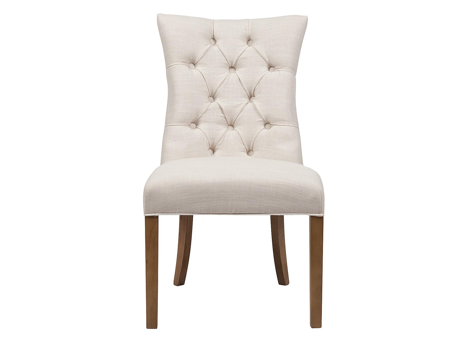 Стул LindorОбеденные стулья<br>Уют в столовой зоне начинается с комфортной мебели, за которой собирается вся семья. Изящный стул&amp;amp;nbsp;&amp;quot;Lindor&amp;quot; — образец безупречного вкуса и &amp;amp;nbsp;внимательного отношения к деталям. Его образ формирует баланс пышно-оформленного верха и уравновешенного низа. Спинка и сидение обиты тканью молочного оттенка в технике капитоне, придавая обстановке легкой торжественности.<br><br>Material: Лен<br>Width см: 64<br>Depth см: 55<br>Height см: 97