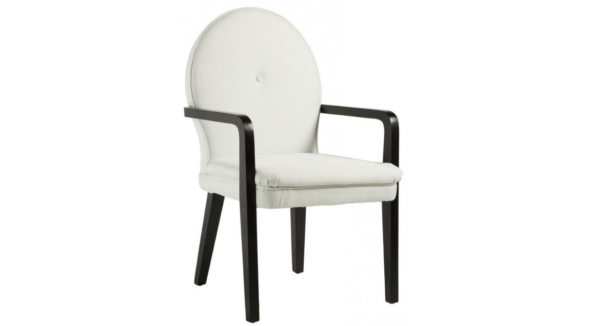 Кресло LouiseСтулья с подлокотниками<br>Это кресло выглядит достаточно современно и в то же время напоминает старинные будуарные стулья. Каркас и ножки выточены из цельного массива, на сиденье – съемная подушка с наполнителем из полиуретана, а обивкой служит практичная плотная ткань. В качестве финального штриха – обтяжная пуговица прямо по центру овальной спинки.<br><br>Material: Текстиль<br>Width см: 58<br>Depth см: 65<br>Height см: 97