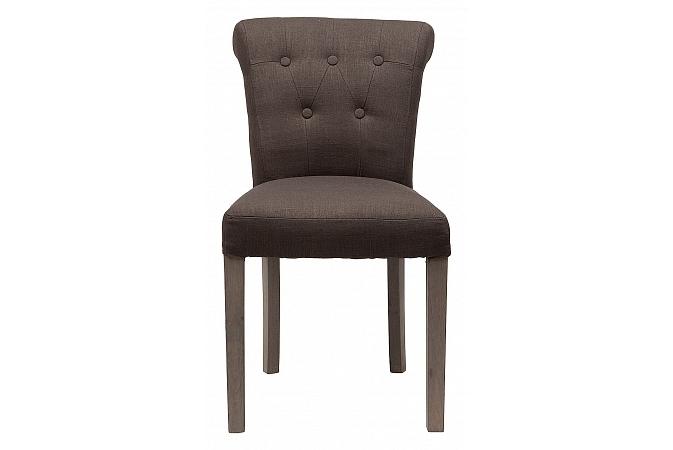 Стул BensonОбеденные стулья<br>Роскошь классического французского стиля в оформлении стула &amp;quot;Benson&amp;quot; обретает абсолютно неожиданное воплощение. Разбавленная нарочитой простотой прованса, она становится сдержанной и романтичной. Лишь кокетливо отогнутая назад спинка, несколько мебельных пуговиц и стройные ножки напоминают о величии дизайна-вдохновителя. В льняной отделке эти детали выглядят более сдержанными и начисто лишаются помпезности.<br><br>Material: Лен<br>Length см: 50<br>Width см: 62<br>Height см: 83