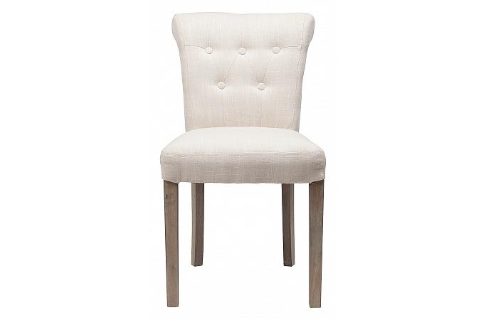 Стул BensonОбеденные стулья<br>Роскошь классического французского стиля в оформлении стула &amp;quot;Benson&amp;quot; обретает абсолютно неожиданное воплощение. Разбавленная нарочитой простотой прованса, она становится сдержанной и романтичной. Лишь кокетливо отогнутая назад спинка, несколько мебельных пуговиц и стройные ножки напоминают о величии дизайна-вдохновителя. В белоснежной льняной отделке эти детали выглядят более сдержанными и начисто лишаются помпезности.<br><br>Material: Лен<br>Length см: 50<br>Width см: 62<br>Height см: 83