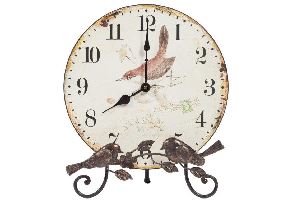 Настольные часы EvergladesНастольные часы<br>Настольные часы Everglades строго выполнены в стиле Прованс — искусственно потертый циферблат с симпатичными птичками, изысканная ковка, растительные мотивы, светлые тона и неброские рисунки. Эффект старины поможет наполнить неповторимостью и оригинальностью вашу спальню, гостиную, кухню или прихожую. Приятный во всех отношениях дизайн и качество изготовления привнесут в интерьер вашего дома уют и теплоту.<br><br>Material: МДФ<br>Diameter см: 31
