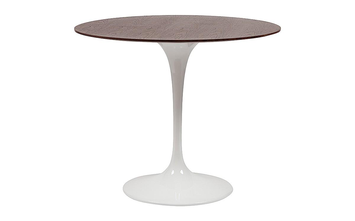 Обеденный стол Saarinen Dining TableОбеденные столы<br>Утонченность урбанистичных материалов, совмещенная с благородством натуральных, создает удивительный по своей гармонии и оригинальности образ. Блеск белого глянца, украшающий грациозную, ультрасовременную ножку &amp;quot;Saarinen Dining Table&amp;quot;, дарит его облику легкость и невесомость. Противопоставлением воплощенной в ней хрупкости выступает столешница из грецкого ореха. Величие и элегантность древесины добавляет статность контрастному виду стола. Эклектичные интерьеры, сочетающие в себе изящество с авантажностью, оживут с таким интересным дополнением.&amp;lt;div&amp;gt;&amp;lt;br&amp;gt;&amp;lt;/div&amp;gt;&amp;lt;div&amp;gt;Цвет: грецкий орех.&amp;lt;/div&amp;gt;<br><br>Material: Дерево<br>Height см: 74<br>Diameter см: 90