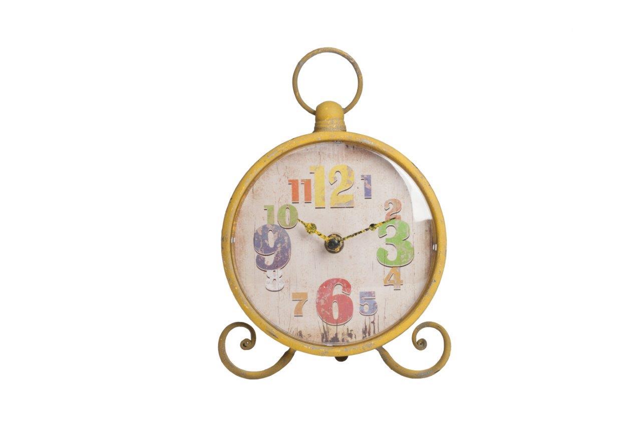 Настольные часы Lumiere YellowНастольные часы<br>Настольные часы Lumiere Yellow — круглой формы на ножках, в виде завитков, сверху вмонтировано кольцо, имеют оригинальный вид. Благодаря жёлтому, немного состаренному, корпусу и оригинальному декору циферблата, в виде разных по величине и цвету цифр, забавный аксессуар непременно впишется в общую картину помещения и будет вызывать улыбку. Выберите часы из коллекции Lumiere любого из четырех цветов — голубого, оранжевого, жёлтого, зелёного.<br><br>Material: Металл<br>Ширина см: 17<br>Высота см: 23