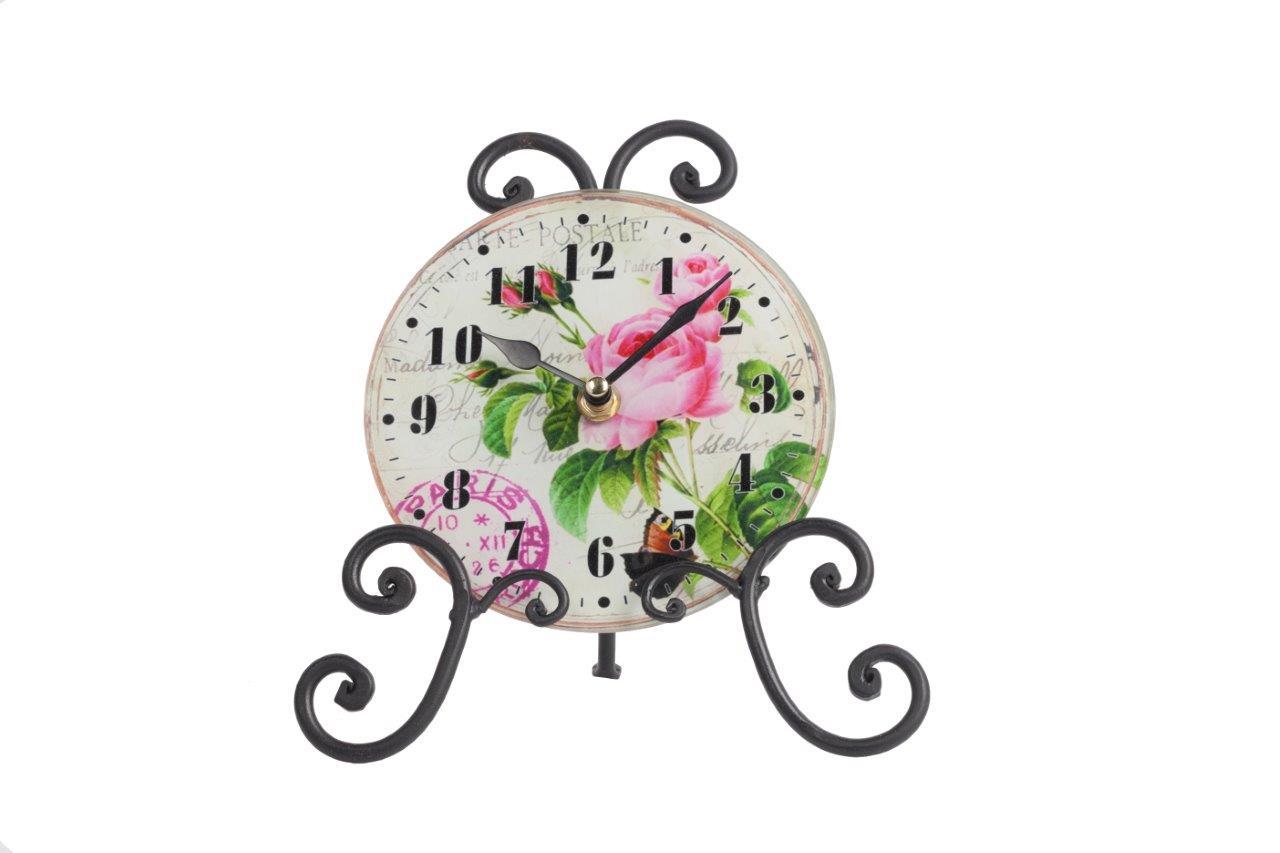 Часы на подставке AnikaНастольные часы<br>Роскошный интерьер складывается из деталей. Часы на подставке Anika — это тот элемент декора, который непременно привнесет в ваш дом дополнительный уют, красоту и изысканность. Необычное сочетание стеклянного циферблата и кованой металлической подставки дает поистине оригинальный аксессуар. Растительные мотивы, украшающие часы, будут отлично гармонировать с общей картиной помещения, оформленного в любом стиле.<br><br>Material: Стекло<br>Width см: 20,5<br>Depth см: 9,6<br>Height см: 21,5