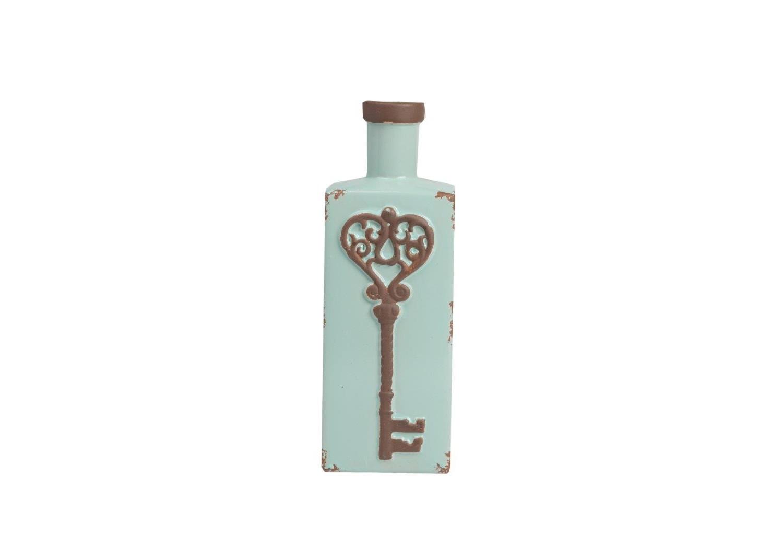 Декоративная ваза IntrigoВазы<br>Декоративная ваза Intrigo — это изящный и роскошный предмет оформления вашего дома. Оригинальное дизайнерское и цветовое решение позволяют аксессуару наполнить помещение шиком и придать ему дорогой вид. Ваза изготовлена из керамики и украшена рисунком в виде старинного ключа. Искусственные потертости и сколы придают ей провинциальное очарование и изысканность.<br><br>Material: Керамика<br>Width см: 12<br>Depth см: 10<br>Height см: 31
