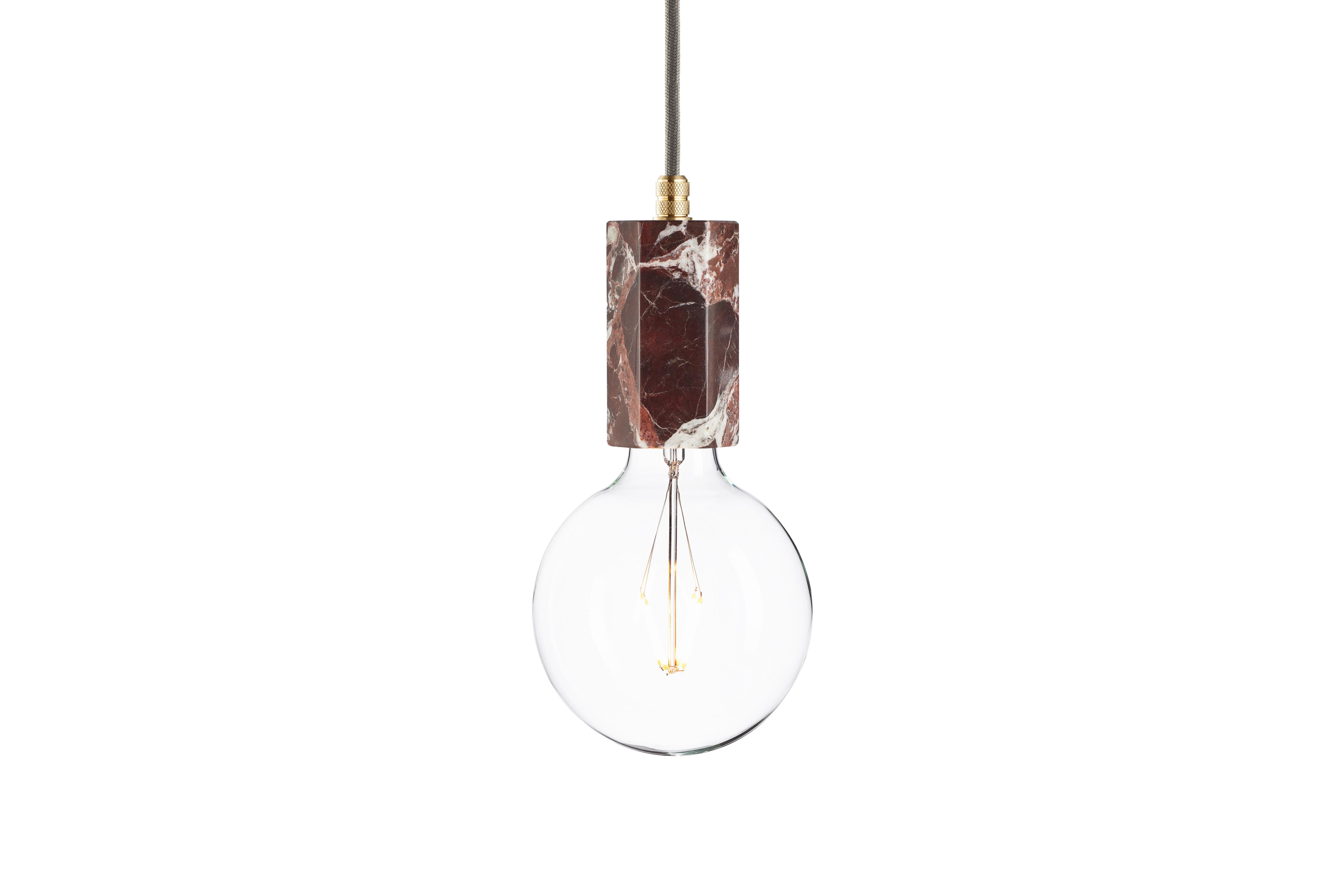 Подвесной светильник Marmor TromПодвесные светильники<br>Светлые линии великолепных узоров сморятся ярко и контрастно на фоне благородного темно-вишневого цвета. Рисунок натурального мрамора дарит особую элегантность оформлению подвесного светильника &amp;quot;Marmor Trom&amp;quot;. Он делает его минималистичный декор в стиле лофт роскошным. Прекрасный пример придания изысканности вещам при помощи отделки.&amp;amp;nbsp;&amp;lt;div&amp;gt;&amp;lt;br&amp;gt;&amp;lt;/div&amp;gt;&amp;lt;div&amp;gt;Лампочка приобретается отдельно. Цоколь Е27, максимальная мощность лампочки - 60 W, длина шнура - 3 м.&amp;amp;nbsp;&amp;amp;nbsp;&amp;lt;/div&amp;gt;&amp;lt;div&amp;gt;Материал: корпус - мрамор Rosso Levanto, фурнитура - латунь, сталь, патрон - пластик, кабель в оплетке. Под заказ. Срок изготовления 3 недели.&amp;amp;nbsp;&amp;lt;/div&amp;gt;<br><br>Material: Мрамор<br>Ширина см: 6.0<br>Высота см: 12.0<br>Глубина см: 6.0