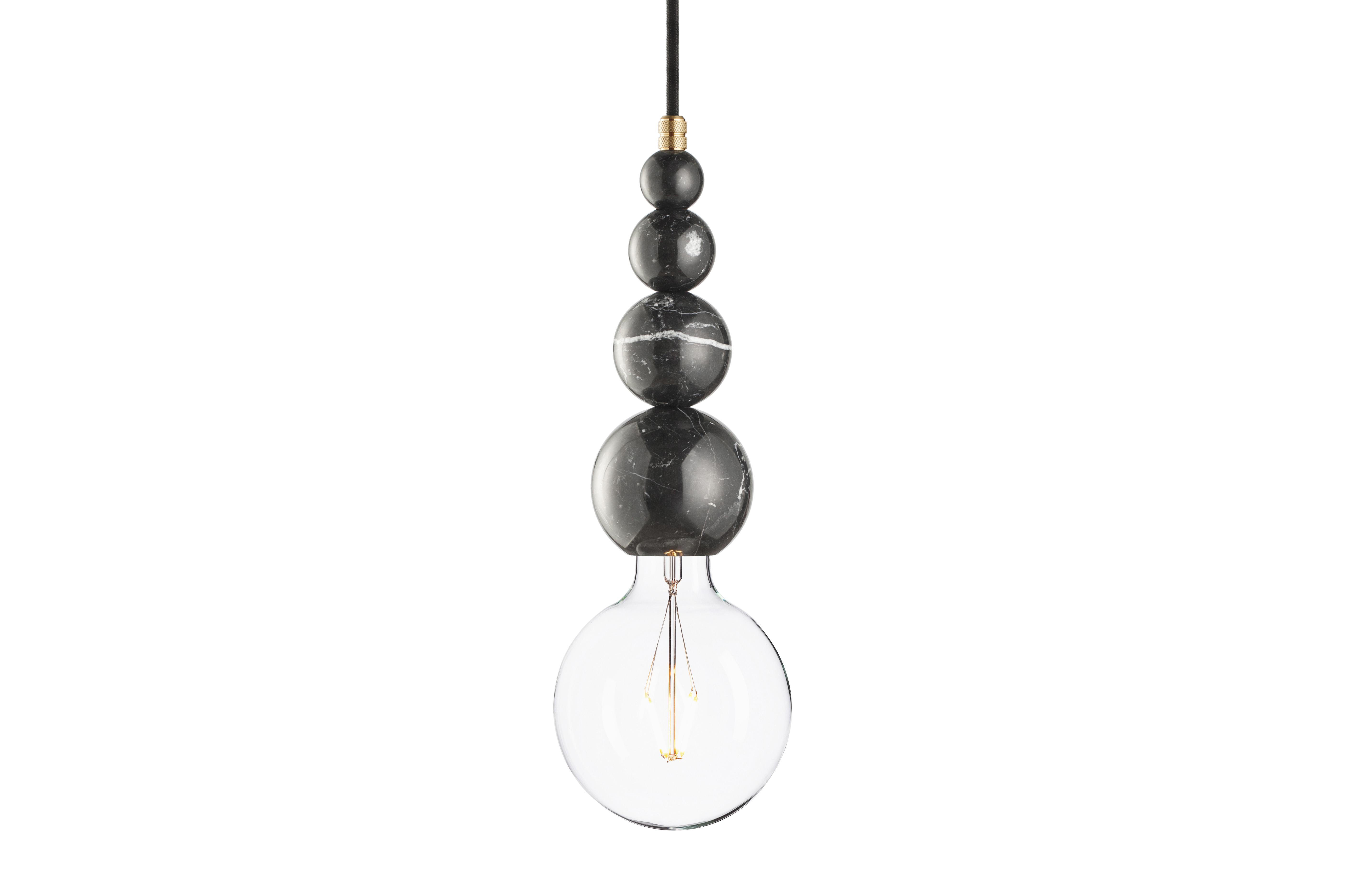 Подвесной светильник Marmor SlippПодвесные светильники<br>Подвесной светильник &amp;quot;Marmor Slipp&amp;quot; выглядит роскошно, несмотря на свою простую форму и строгость оформления. Удивительную элегантность ему дарит завораживающий узор настоящего черного мрамора. Глянцевые переливы смотрятся шикарно на пропорционально увеличивающихся сферах, служащих основанием оригинального эклектичного светильника.&amp;lt;div&amp;gt;&amp;lt;br&amp;gt;&amp;lt;/div&amp;gt;&amp;lt;div&amp;gt;Лампочка приобретается отдельно. Цоколь Е27, максимальная мощность лампочки - 60 W, длина шнура - 3 м.&amp;amp;nbsp;&amp;amp;nbsp;&amp;lt;/div&amp;gt;&amp;lt;div&amp;gt;Материал: корпус - мрамор &amp;amp;nbsp;Nero Marquinia, фурнитура - латунь, сталь, патрон - пластик, кабель в оплетке. Под заказ. Срок изготовления 3 недели.&amp;amp;nbsp;&amp;lt;/div&amp;gt;<br><br>Material: Мрамор<br>Height см: 23,4<br>Diameter см: 8,6