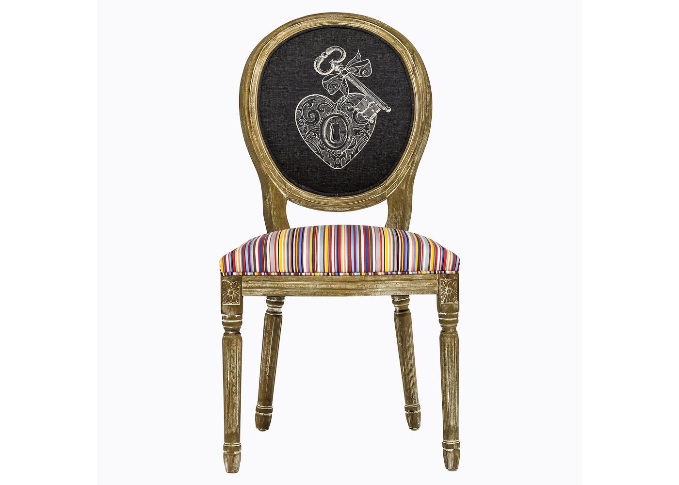 """Стул «Ключ к сердцу / Страйп»Обеденные стулья<br>Дизайн стула &amp;quot;Ключ к сердцу / Страйп&amp;quot; предназначен тем, кто видит стулья не бытовым предметом, а парадным интерьерным украшением, способным задать пространству стиль и достоинство. Искусное патинирование - не только дань винтажной моде, но и справедливый намек на исключительную долговечность мебели из натурального дуба. Обивка стула изготовлена из """"Тканей Солнца"""" французского дома Les Toiles du Soleil, - мирового лидера производства интерьерных тканей. Мягкость, комфортабельность и долговечность сидения обеспечены внутренней подвеской из эластичных ремней.<br><br>Material: Дерево<br>Ширина см: 50<br>Высота см: 99<br>Глубина см: 58"""