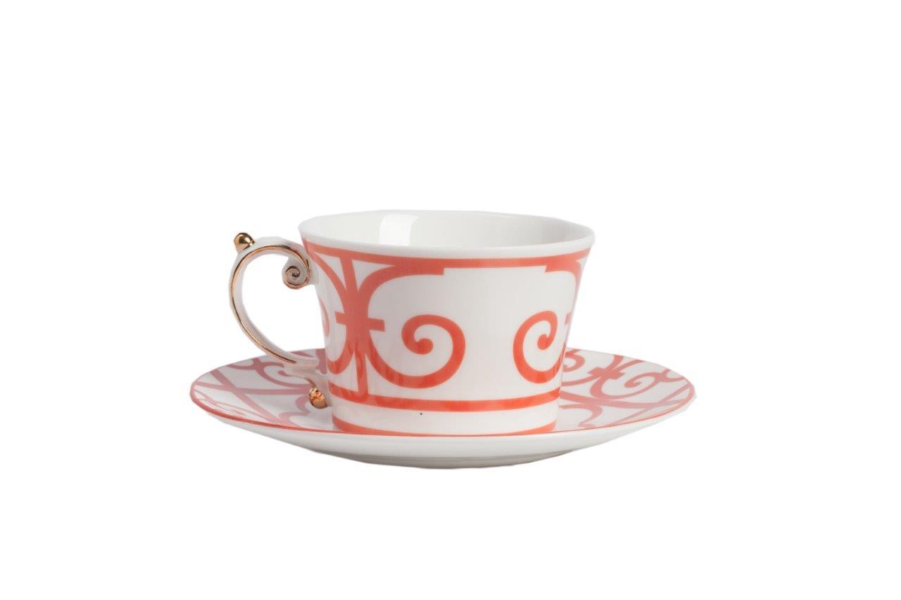Чайная пара SkarlettiЧайные пары, чашки и кружки<br>Чайная пара Skarletti из грубой керамики, декорированная красным орнаментом и золотым напылением. В пару входят чашка и блюдце. Если вы предпочитаете восточный стиль в сервировке — коллекция посуды Skarletti создана специально для Вас! в нашем интернет-магазине в этой коллекции представлены также комплекты тарелок, блюда, сахарницу, заварочный чайник и молочник, что позволит вам подобрать идаельный набор с нужным количеством предметов.<br><br>Material: Фарфор<br>Width см: 11<br>Depth см: 9<br>Height см: 7