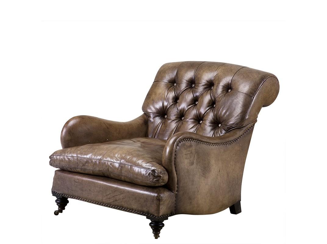 КреслоКожаные кресла<br>Кресло Club Caledonian с подлокотниками. Обтянуто кожей светло-оливкового цвета. Деревянные черные ножки на колесиках. На седушке съемная подушка. Модель выполнена в технике &amp;quot;Капитоне&amp;quot;. Декорировано металлическими заклепками.<br><br>Material: Кожа<br>Width см: 75<br>Depth см: 70<br>Height см: 76