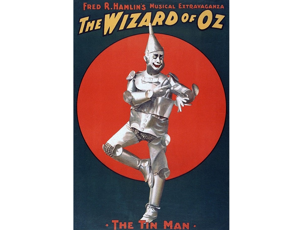 Постер The Wizard of OzПостеры<br>Fred R. Hamllins Musical Extravaganza. The Wizard of Oz. The Tin Man.   <br>  Фред Р. Хэмлин Музыкальная феерия. Волшебник страны Оз. Оловянный Человек  .<br>Ретро плакат с рекламой мюзикла об оловянном человечке из страны Оз стал отличным постером, который уже готов переехать в Ваш дом, чтобы создать в нем романтическую атмосфер минувших дней, где кавалеры приглашали дам на мюзиклы. Волшебное чувство предвкушения спектакля, огромные очереди за билетом, запах сладкой ваты и поп-корна - это восхитительная смесь вкусов и эмоций, которые так редко можно испытать в век интернета и кабельного телевидения. <br>Каждому из нас знакома эта удивительная история о путешествии маленькой девочки Элли в волшебную страну Оз, где великий и могущественный волшебник поможет ей и её друзьям исполнить их мечты.<br>Подарите себе частичку детства и сказочного полумрака театрального зала.<br><br>Material: Бумага<br>Width см: 59<br>Height см: 84