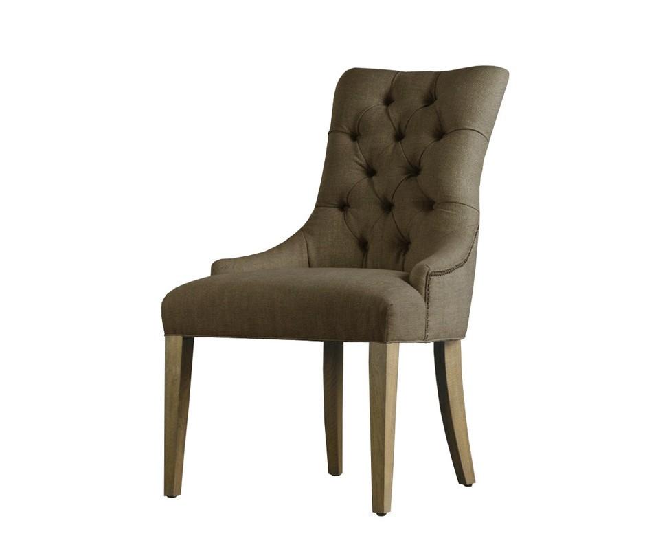 Стул MARTINОбеденные стулья<br>&amp;quot;Martin&amp;quot; ? невероятно изысканный стул, чье оформление хранит в себе подлинную роскошь английского стиля. Спинка, декорированная кнопками, плавно переходит в сиденье, располагающееся на утонченных ножках. Льняная обивка бежевого цвета делает вид стула изящным.<br><br>Material: Лен<br>Length см: None<br>Width см: 61.0<br>Depth см: 69.0<br>Height см: 98.0<br>Diameter см: None