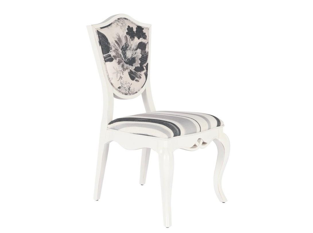 Стул PAOLAОбеденные стулья<br>Лирика прованса добавляет кухне или спальне очарование прекрасной непосредственности. Стул &amp;quot;Paola&amp;quot; смотрится очень изысканно и элегантно. Гнутые ножки, фигурная спинка, отделка лаком молочного-белого цвета и обивка с цветочным принтом ? вот что делает его романтичный облик исключительным.<br><br>Material: Текстиль<br>Width см: 55.5<br>Depth см: 57<br>Height см: 99